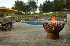 Beautifully designed backyard paradise with unique fire pit focal point.