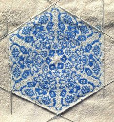 Behold the possibility of knitted fabric: CeruleanSarah's blue tiles.