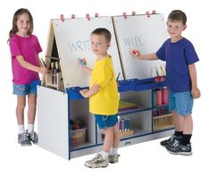 Jonti-Craft's Rainbow Accents Easel Stations foster artist creativity and keep art supplies within children's reach. Write-n-Wipe easel panels are standard, Acrylic and Chalkboard panels are optional. Clips and paint trays included. Nursery Furniture Collections, Nursery Furniture Sets, Kids Furniture, Kids Art Easel, Green School, Painted Trays, School Play, Thing 1, Toddler Activities
