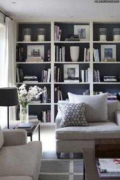 Family room - Dark Bookshelves (dark cupboard doors too) with white trim Interiors Trend
