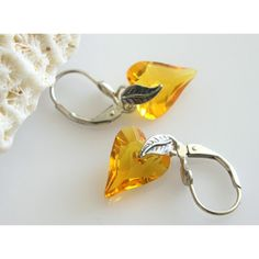 Swarovski Yellow Earrings, Sunflower Yellow Crystal, Wild Heart... ($23) ❤ liked on Polyvore featuring jewelry, earrings, yellow jewelry, earring jewelry, yellow earrings, sterling silver crystal earrings and crystal jewellery