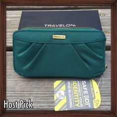 HP: Travelon RFID Blocking Clutch Wallet This Travelon clutch wallet is perfect to use as a small purse. Usable as a clutch or carried in your purse as a wallet the double zip carrier keeps your identity from unauthorized access with its RFID blocking protection. Features a removable wrist strap. NWT and in box.  Best in Boutiques Host Pick. Travelon Bags Clutches & Wristlets