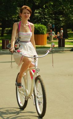 girl in white on white bicycle