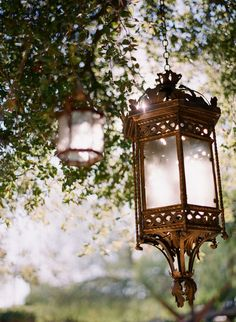 Could these lanterns hanging from trees at a garden wedding be more beautiful?