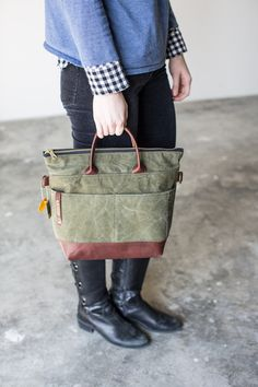 Handbag Made from MilitaryCanvas + Genuine Brown Leather The Otto is a bag for only the most passionate fashionistas who pride themselves on shopping outside o