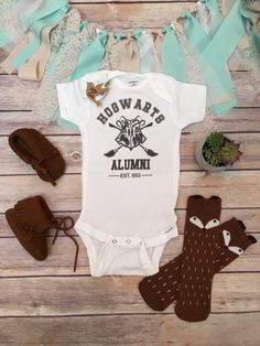 "Hogwarts Alumni - Harry Potter baby Onesie® (or T-Shirt) Unisex Harry Potter baby Onesie® (or T-Shirt) perfect for a boy or girl with ""HOGWARTS ALUMNI est. 993"" and the iconic Harry Potter quidditch b"