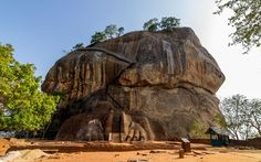 """23. Sigiriya, Sri Lanka    The fortress of Sigiriya stands on an outcrop of volcanic rock, and the only way to access it is to enter through the """"lion's mouth"""", a passageway that climbs up between a pair of huge stone paws carved in the sheer rock face."""
