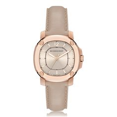 Model Burberry The Britain Rose Gold Plated Quartz Ladies Watch BBY1503  Functions British design, Swiss made, 38mm, rose gold plated stainless steel case, trench leather strap, quartz movement, scratch resistant sapphire crystal glass, water resistant to 50 metres.  Features A contemporary and elegant collection, The Britain combines the best of British design with top, Swiss watch-making craft culminating in a stunning series of timepieces. Utilising Burberry's iconic trench coat palett...