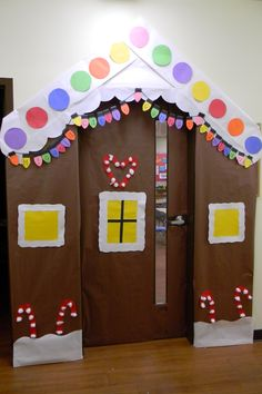 DIY Gingerbread house bulletin board/door decoration for a classroom. LOVE it for christmas/winter time!