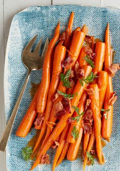 Orange-Glazed Carrots with Bacon – Next time you see beautiful fresh carrots with tops at the farmers' market—grab 'em! And try out this beautiful side dish with crumbled bacon and orange zest.