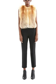 Our cropped, collarless red fox vest can be layered over a thick wool cable knit or silk charmeuse and worn under your favorite down-filled nylon puffer for add