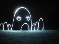 light painting - achieved using a slow shutter speed and flashlights. I am so going to try this sometime!