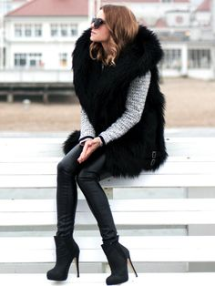 sleeveless fur coat with black leather or pvc leggings