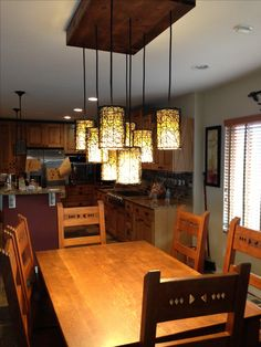 Dining room light fixture - like the mason jar one but the homeowner substituted shades from Lowes. Like this idea Dining Room Light Fixtures, Kitchen Lighting Fixtures, Dining Room Lighting, Home Lighting, Lighting Ideas, Low Ceiling Bedroom, Finish Kitchen Cabinets, Living Room Update, Lights