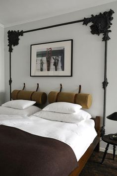 Set in a Vienna apartment, this equestrian inspired bedroom creates a classic masculine feel by combining leather, crisp white linens, and a camp style blanket.