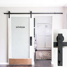 How to build your own DIY Barn Door Hardware on a budget. No words, no kick plate, just frosted glass