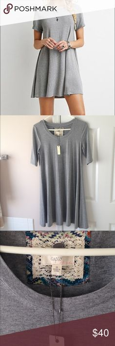 """CUPIO GRAY LOOSE FIT TSHIRT DRESS NO TRADES -  length is 36"""" from shoulder to hem. Color is a heather gray. Material is lightweight and silky. Beautiful casual and chic. 87% Viscose 13% spandex.  Model is 5'9"""" so it will be longer if you are shorter Cupio Blush Dresses"""
