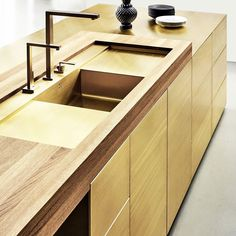 It worth a look for the exclusive caring of details!  At Biennale Interieur 2016 @multiform presented the new version of Form 1 Kitchen: all edges are bevelled with diagonal cut at 45 to create a rigid monolith in the room. #archiproducts