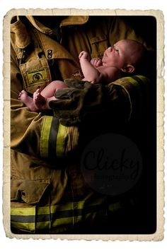 Fire fighter and baby.