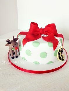 chocolate cake with dark chocolate ganache..  sugar reindeer & a gift tag made of sugar fondant & gum paste.  Merry Christmas, everyone!