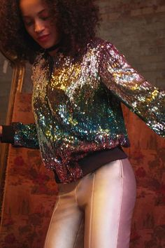 The bomber jacket is transformed with this cool style. In an all-over sequin and velvet iridescent finish, it comes with zip up fastening. We've styled with jeans and ankle boots for a look that's right for both day and night. #Topshop