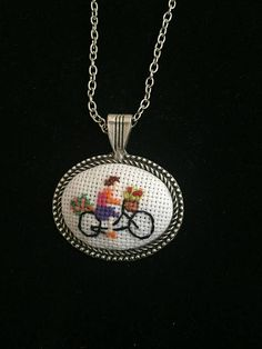 Handmade elegant cross stitch necklace with detailed bicycle pattern. I can adjust the length of the chain if you like. Let me know if you have any question