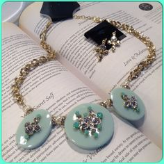 Mint Green Necklace Set This gorgeous set set on gold tone chain features flat stones embellished with rhinestones in cross shapes with matching cross earrings. Measures 17 inches long with a 2 inch extender. Earrings are 1.5 inches long. (This closet does not trade or use PayPal) Jewelry Necklaces