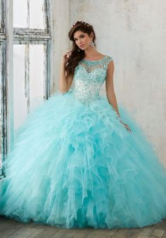 Quinceanera Dresses by Morilee designed by Madeline Gardner. This Ruffled Tulle Ballgown Features a Beautifully Beaded Bodice and Keyhole Corset Back.