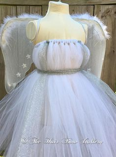 Beautiful Angel tutu dress done in white and silver glitter tulle! Perfect for pictures or as a Halloween costume. This set includes Angel wings and the tutu dress. This angel costume is a full length dress, comes down to the ankles. Visit our shop to see other adorable items