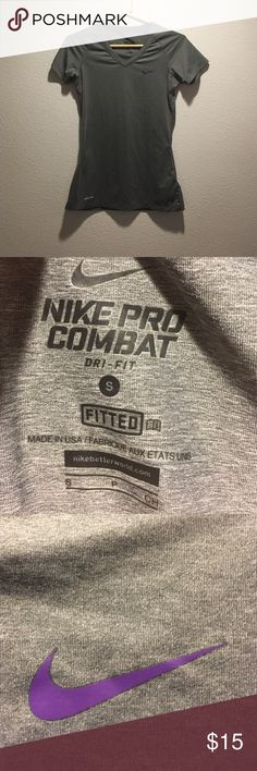 Nike Pro combat fitted shirt Nike Pro dry fit fitted shirt. In gray with purple accents. It is in in great shape. Nike Tops Tees - Short Sleeve