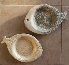 Hand built clay textured fish plates.