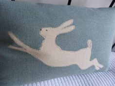 Hand printed duck egg leaping hare cushion cover by helkatdesign, $74.00