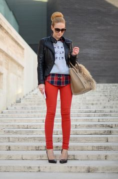 Black leather jacket, graphic Tee or sweatshirt, plaid shirt, red or colored jeans