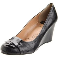 Wedge heels in black - I've found that, since I started practicing law, dressy wedge heels and interesting black flats are the shoes I wear until they disintegrate.