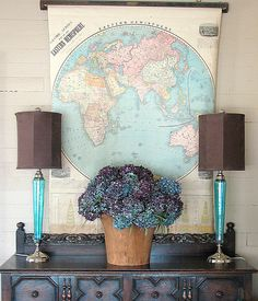 turquoise and chocolate brown - totally love flowers but would change out the globe map for myself.