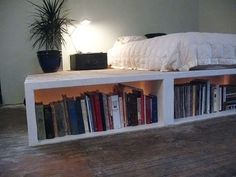 Homemade platform bed with storage for books (lit up from behind said books ... check the website)