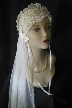 Eve tried on her wedding veil one last time before her big day. 1920's Wedding Veil by lacesparklevintage on Etsy,