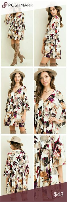 Leila Bohemian Dress Floral Print baby doll button down dress featuring 3/4 bell sleeve. Full-sized. Non-sheer. Woven. Lightweight.   100% Rayon Dresses