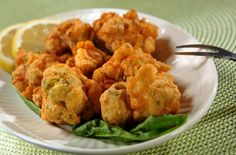 Seafood Fritters: 1/4 lb. conch, 1/4 lb. shrimp, peeled & chopped, 1/4 lb. snapper or any fish, 1/2 medium onion, 1/2 medium red & green pepper & 2 celery stalks chopped, 1 jalapeno, seeded/chopped 1 1/3 cup flour sifted, 2 tsp baking powder, 1 egg, 8 dashes Tabasco, 1 1/2 tbs. salt, 1 1/3 cup milk. Combine seafood, vegetables, salt & Tabasco mix well. Add flour, baking powder egg & mix. If too thin, add flour; if too thick, add 1 TBS milk Spoon into oil heated to 350º. Cook until golden brown