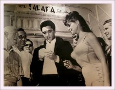 "Elvis Presley signs autographs on July 26, 1963 at the Sahara in Las Vegas, where he and Ann-Margret filmed what would be Presley's 15th film, ""Viva Las Vegas."" The Sahara Hotel and Casino in Las Vegas opened its doors in 1952 and closed its doors on May 16, 2011."