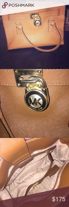 Michael Kors tan bag Tan bag with gold accents. I'm great condition. Michael Kors Bags