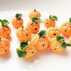 Cute miniature pumpkins handmade from polymer clay by Fizzy.