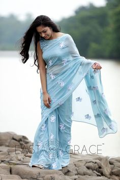 Featuring a soft powder blue pure silk chiffon saree with light white ribbonwork floral motifs embroidered all over it. Please visit this link to purchase the saree. Please visit this link to purchase the saree. Fancy Sarees, Party Wear Sarees, Chiffon Saree, Silk Chiffon, Organza Saree, Floral Chiffon, Indian Dresses, Indian Outfits, Collection Eid