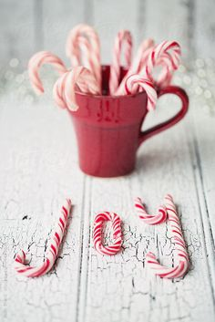 """Candy canes spelling the word """"joy"""" by Ruth Black - Stocksy United - Royalty-Free Stock Photos"""