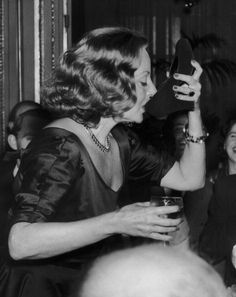 American actress Tallulah Bankhead drinks champagne from her shoe during a press conference at the Ritz Hotel in London, September Get premium, high resolution news photos at Getty Images Katharine Hepburn, Vintage Hollywood, Classic Hollywood, Hollywood Party, Hollywood Hills, Hollywood Star, Tallulah Bankhead, Broadway, Woman Wine