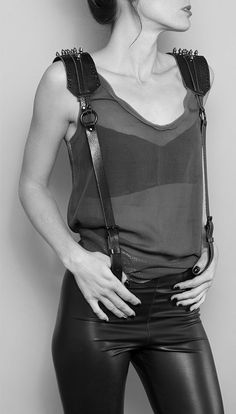 Black leather suspenders with silver bullet spikes at the top shoulder, paired with 4-way stretch black vegan leather leggings.. Get the supplies to make it: http://mjtrends.com/pins.php?name=silver-bullet-spikes-and-studs