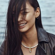 Modernist statement. Slide off the pearl pendant to wear the sleek, collar on its own.