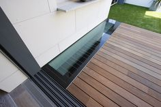 A walk on glass floor light in the new roof garden decking allows light into living spaces below