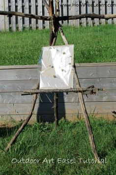 Using sticks from a tree to make an art easel for outside! Love the idea of taking art into nature.