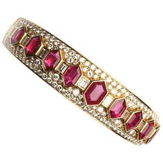 Bulgari Iconic Ruby Diamond Bangle Bracelet | From a unique collection of vintage bangles at https://www.1stdibs.com/jewelry/bracelets/bangles/